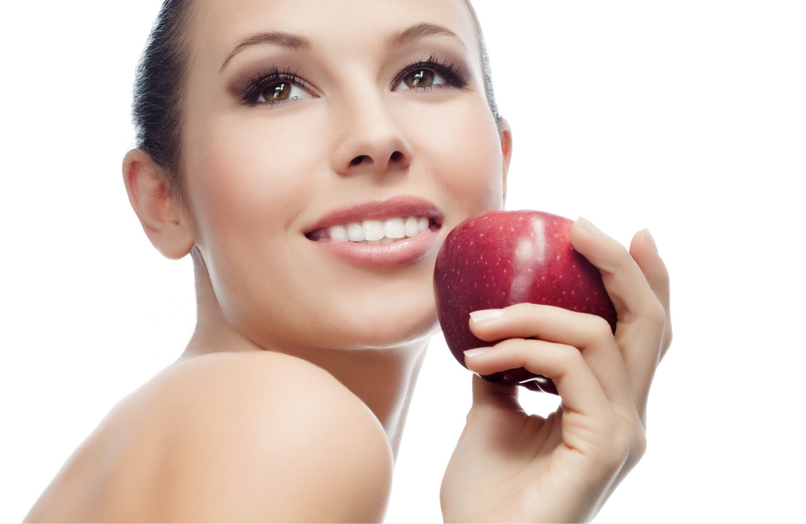 girl holding apple smiling
